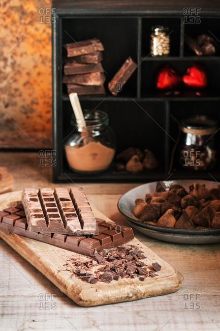 Scene with various chocolates, plate with truffles and chocolate