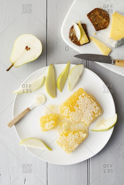 Honeycomb on a plate with pears, cheese and crackers