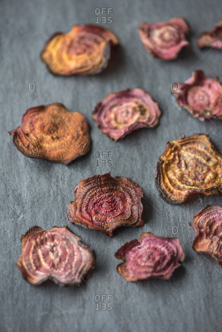 Homemade beet chips on slate