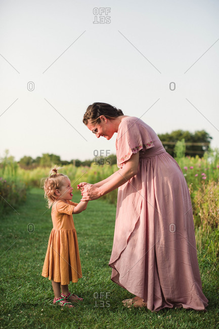 Mother and child playing dancing game in the country