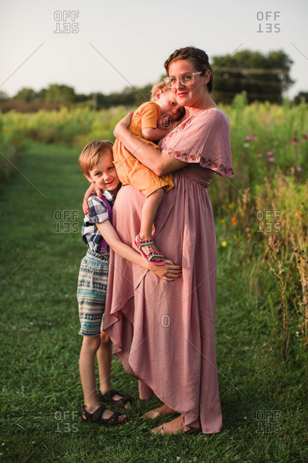 Affectionate Maternity Portrait With Mom And Siblings Stock Photo