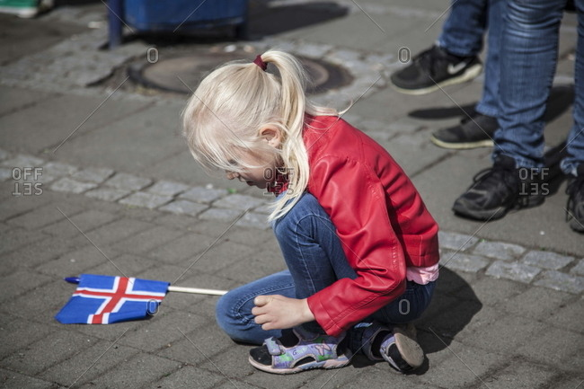 Akureyri, Iceland - June 17, 2016: A girl playing with the Icelandic flag during the celebration of Iceland National Day