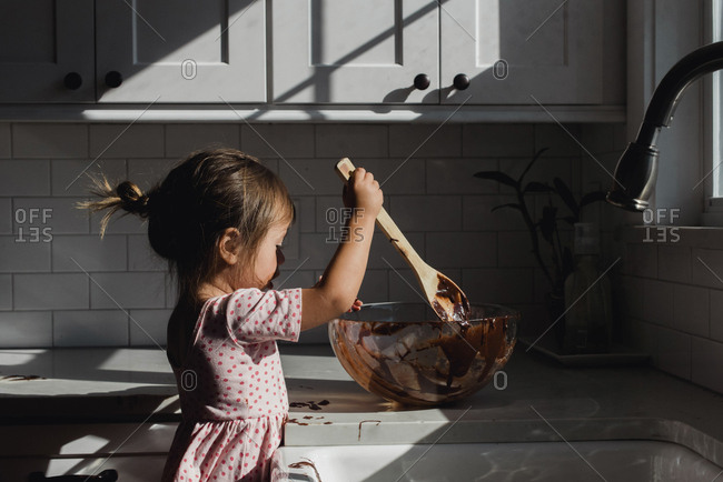 Toddler making brownies
