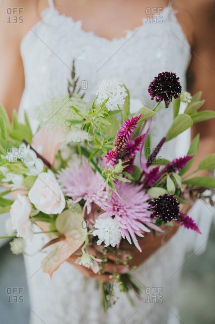Bride holding a modern floral bouquet