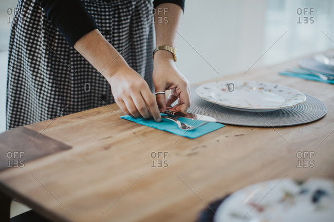 Brazilian woman setting a table for a family lunch