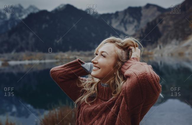 Woman admiring the view of mountain lake