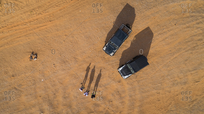 April 14, 2017: Aerial selfie of friends with their safari cars in the Camel Rock Desert  in UAE.