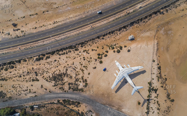 Aerial view of the old abandoned russian cargo plane in Umm Al Quwain Airport, United Arab Emirates.