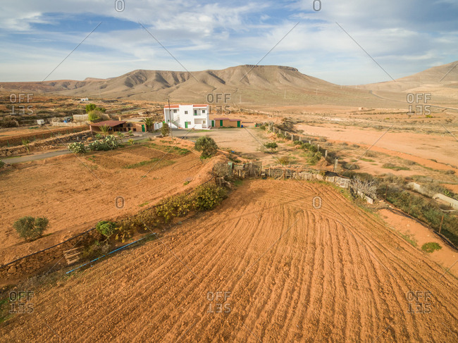 FUERTEVENTURA, CANARY ISLANDS - 13 February 2018 : Aerial view of ranch in dry land of Fuerteventura, Canary Islands.