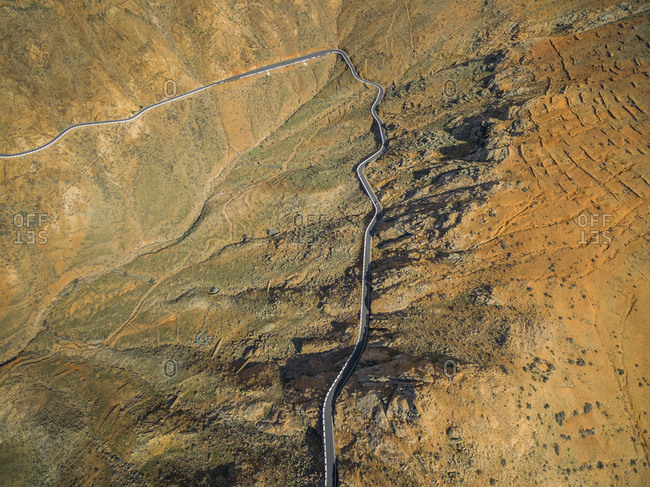 Aerial view of the famous winding mountain road that links the small towns of Casillas del Angel and Pajara in Fuerteventura, Canary Islands.