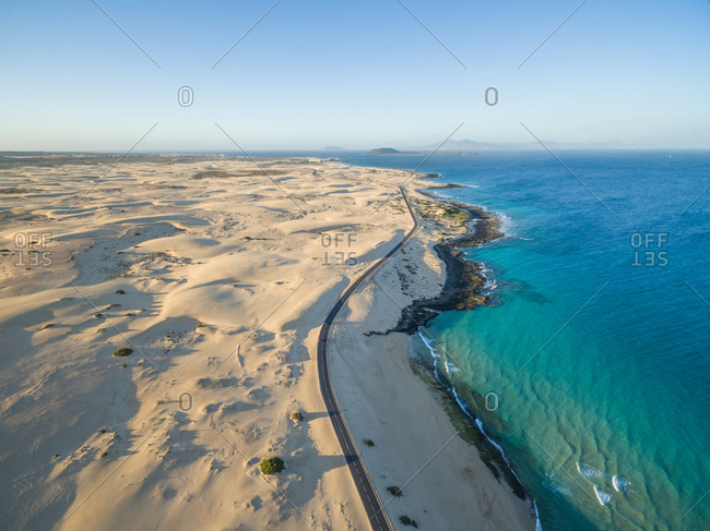 Aerial view of Corralejo Dunes Natural Park and sea in Fuerteventura, Canary Islands.