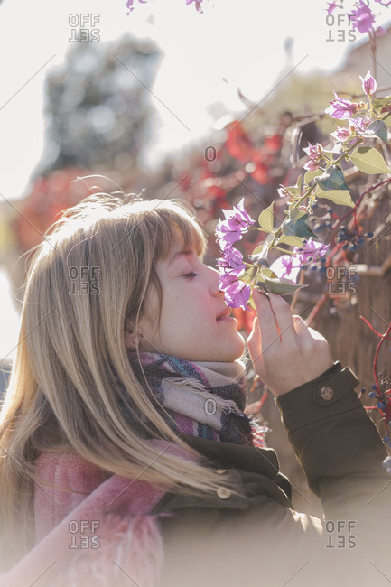 Woman smelling flowers outdoors