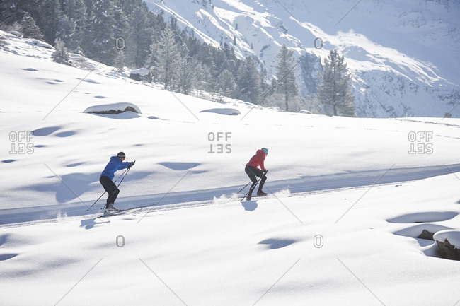 Austria- Tyrol- Luesens- Sellrain- two cross-country skiers in snow-covered landscape