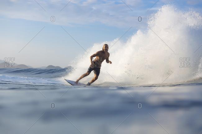 Indonesia- Sumatra- happy man surfing