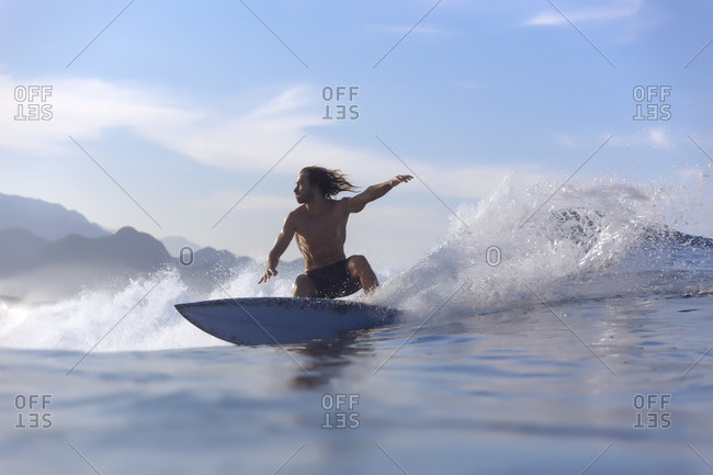 Indonesia- Sumatra- surfer on a wave