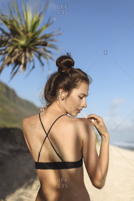 Rear view of attractive young woman on the beach