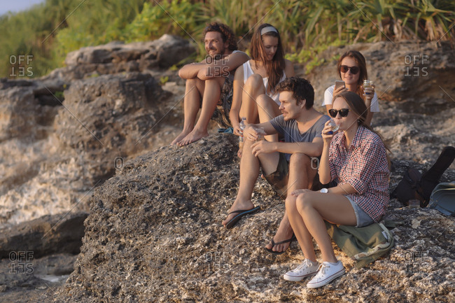 Indonesia- Bali- Lembongan island- friends having a drink at ocean coast