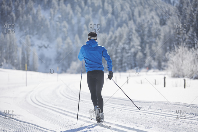 Austria- Tyrol- Luesens- Sellrain- cross-country skier in loipe in snow-covered landscape