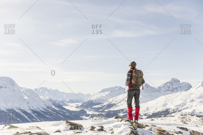 Switzerland- Engadin- hiker in mountainscape looking at view