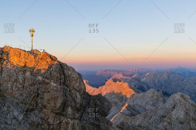 Austria- Germany- Bavaria- Zugspitze- summit cross in the evening light