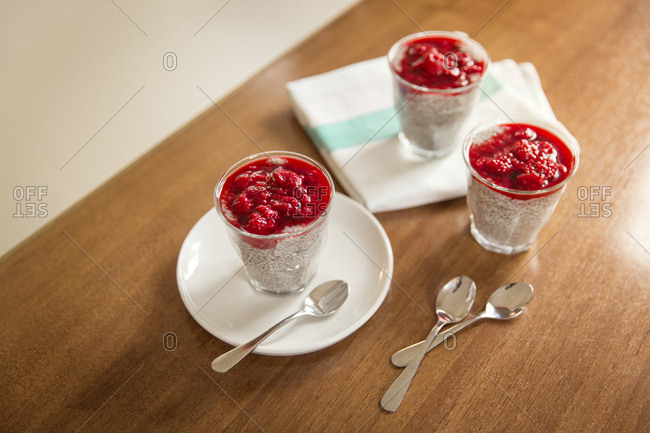 Chia pudding with raspberry topping on kitchen counter