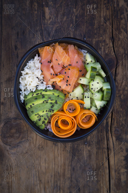 Sushi-Bowl with salmon- avocado- cucumber- rice and carrot
