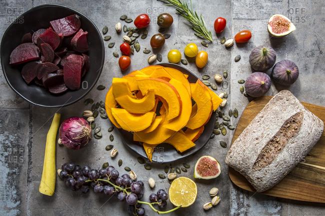 Pumpkin panzanella- bread salad of pumpkins- onions- tomatoes- grapes and figs