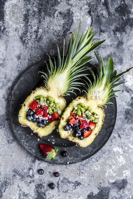 Sliced ananas with fruits- kiwi- strawberry and blueberry
