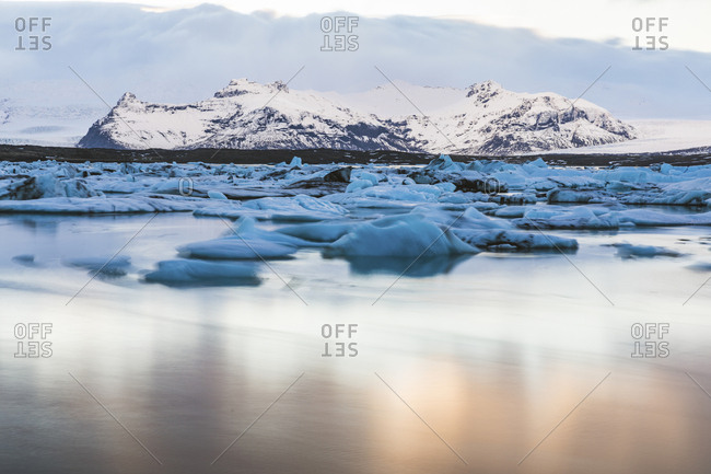 Iceland- Hof- Jokulsarlon lagoon with icebergs and mountains