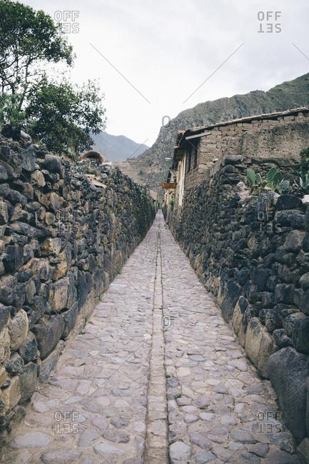 Peru - February 10, 2017: Empty alley amidst stone wall against sky