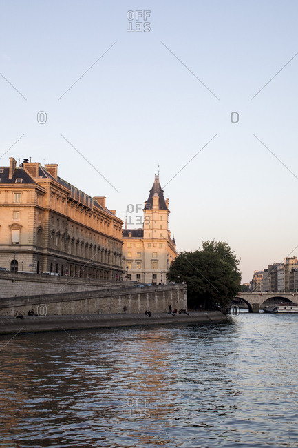 France, Paris - May 5, 2017: Seine River by buildings against clear sky during sunset in city