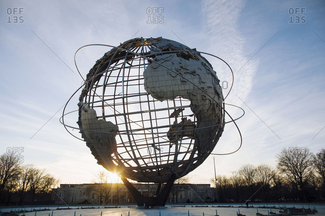 USA, New York, Queens - February 4, 2017: Large globe against sky at Flushing Meadows Corona Park