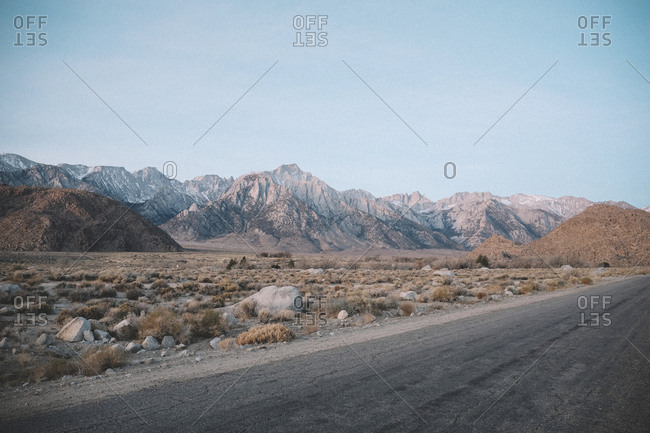 Empty road amidst landscape against clear sky