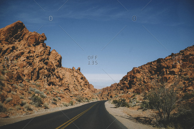Empty road against sky during sunny day at Valley of Fire State Park