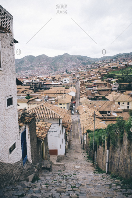 High angle view of houses in city against mountains and sky