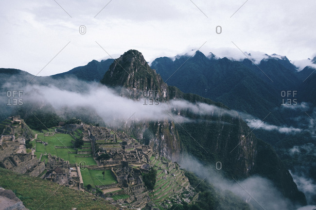 High angle view of old ruins on mountain against sky