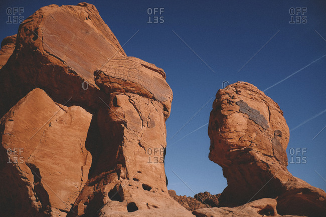 Low angle view of rock formations against clear blue sky at Valley of Fire State Park