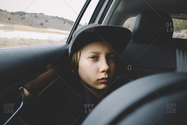 Portrait of boy wearing cap while traveling in car