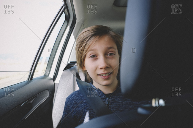 Portrait of smiling boy traveling in car