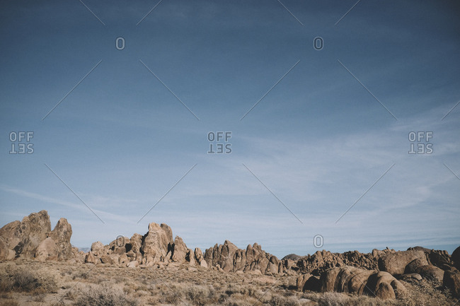 Scenic view of rock formations against sky at desert