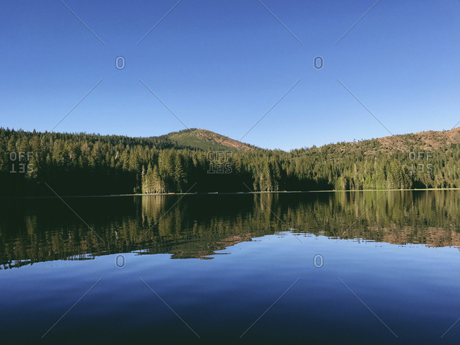 Scenic view of Rucker Lake against clear blue sky