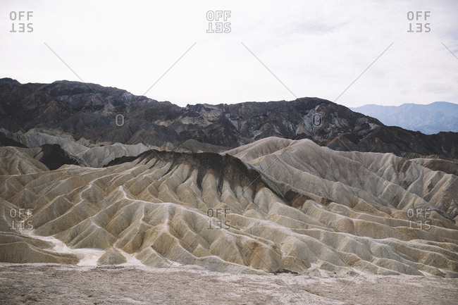 Tranquil view of dramatic landscape against sky at Death Valley National Park