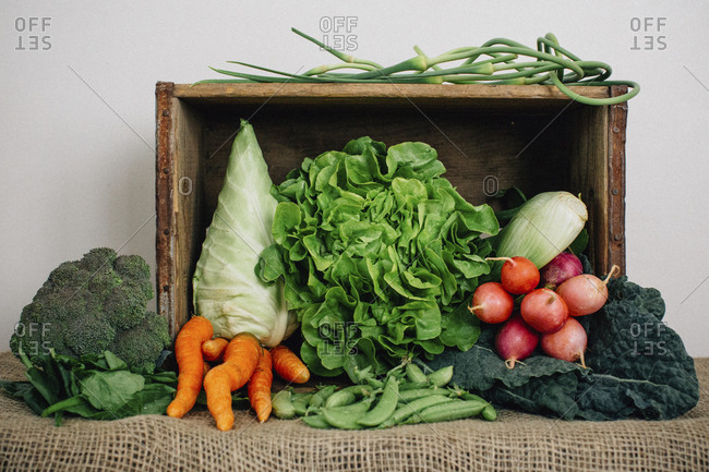 Vegetables in box with burlap on table
