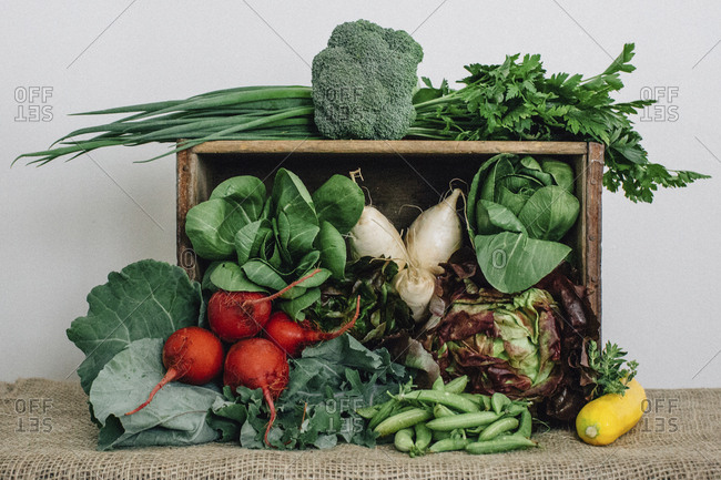 Vegetables with wooden box and burlap on table