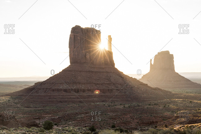Scenic view of butters at Monument Valley Tribal Park against sky during sunset