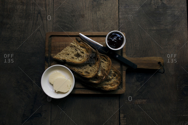 Close-up of breakfast served on cutting board over wooden table