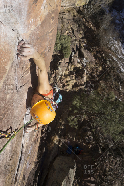 High angle view of confident female hiker climbing mountain