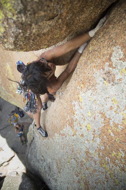 High angle view of hiker climbing mountain