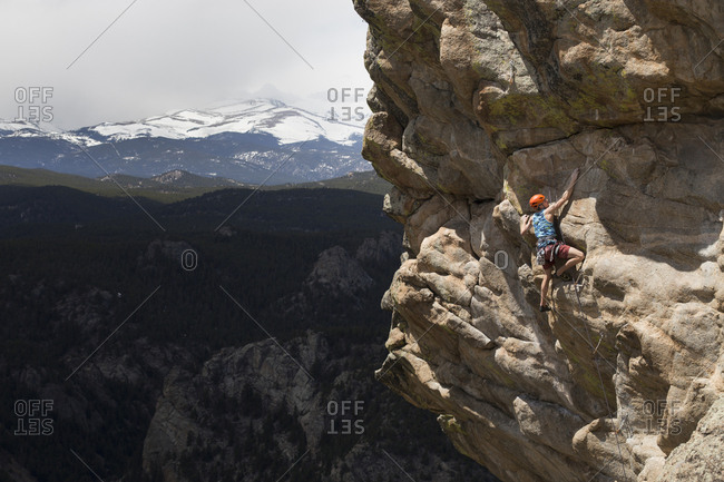 Rear view of male hiker climbing mountain