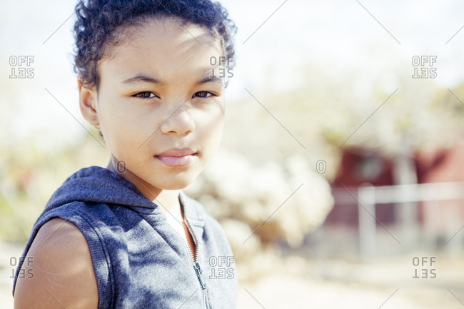 Portrait of confident girl outdoors